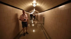 Hoover Dam walking through curved hallways - stock footage