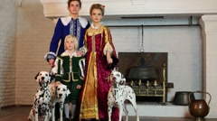 Father, mother and son in medieval costume stand near fireplace Stock Footage