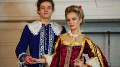 Man and woman in medieval costumes smile and look at each other Stock Footage