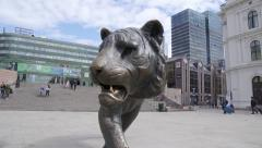 Tiger monument in bronze at Oslo City slider move Stock Footage