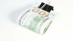 Stack dollars with clip - stock footage