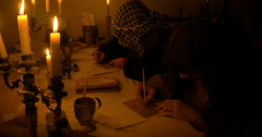 Two ancient scribes writing  letter Stock Footage
