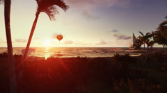 People on the beach at sunrise, air ballon and yacht passing Stock Footage