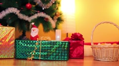 Decorated christmas tree, gift boxes and basket in room Stock Footage