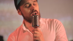 Sexy singer with beard singing in night club Stock Footage