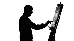 Talanted painter drawing a painting by oil paints and finishes it, evaluates Stock Footage