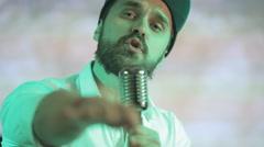 Brutal guy sings a song in karaoke - stock footage