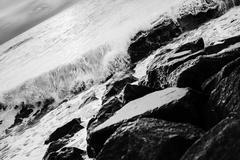 Waves on rocks - stock photo