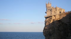 Castle Swallows Nest on cliff near sea with skyline Stock Footage