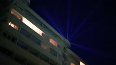 Building with balconies with illumination at summer night Stock Footage