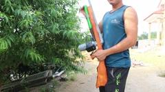 Through shoulder view of a man shooting a gun, sporting gun - stock footage