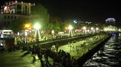 People walk on embankment at night In Crimea Stock Footage