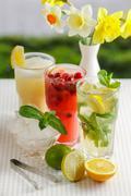 Three glasses of refreshing drink Mohito - stock photo