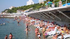 People rest on beach. In 2014 Russia appropriated Crimea Stock Footage