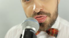Close up of a singer performs songs in karaoke in microphone - stock footage