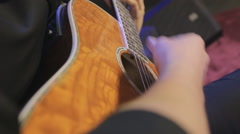 Close-up playing of the classic guitar in the night club Stock Footage
