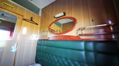 Interior of business-class compartment in moving train with sofa Stock Footage