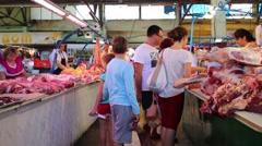 People choose fresh meat on market in Simferopol. Stock Footage