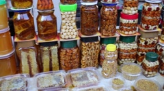 Counter with natural sweets, nuts and honey packed in jars Stock Footage