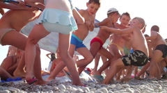 Children tug of war on beach. Yalta - city-resort in southern Crimea Stock Footage