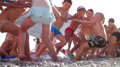 Children tug of war on beach. Yalta - city-resort in southern Crimea - stock footage