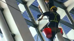 Window Washers In Shanghai Airport Working Hard Stock Footage