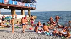People sunbath on beach in Crimea, Ukraine. Stock Footage