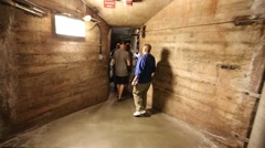 Hoover Dam walking into penstock viewing area - stock footage