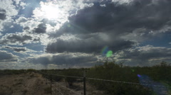 Clouds and virga in motion over desert ranch Stock Footage