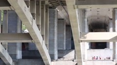 Under view of modern bridge in city. View from sailing ship - stock footage