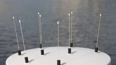 Stock Video Footage of Close up of antenna on ship and ripple on water at sunny day