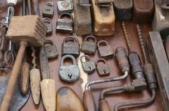 hand drill and rusty padlocks and planers at flea market - stock photo