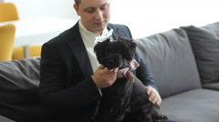 Man in tuxedo with small dog Stock Footage