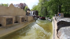 Tourists enjoying the Pirana wild water attraction in the Efteling Stock Footage