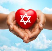 Close up of hands holding heart with jewish star Kuvituskuvat