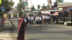 Sumatra, school children walking on the street Stock Footage