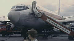 London 1972: aircraft in the strip disembarking passengers - stock footage