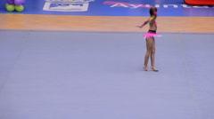 Young gymnast with string on rhythmic gymnastics tournament - stock footage