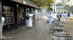 Pilgrims at Sri Maha Bodhi (sacred bodhi tree) in Anuradhapura Stock Footage