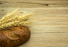 Bread with sesame seeds and ears - stock photo