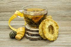 Dietary jasmine tea and dried pineapple - stock photo