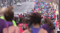 Toronto marathon runners running through the street of Toronto Stock Footage