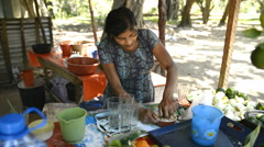 local woman producing juice from limes in Anuradhapura, Sri Lanka - stock footage