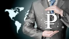 businessman protecting ruble  symbol - stock photo