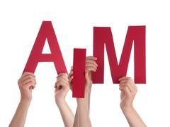 Many People Hands Holding Red Word Aim - stock photo
