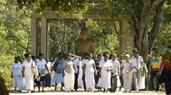 Pilgrims at Samadhi Buddha Statue in Anuradhapura, Sri Lanka. Stock Footage