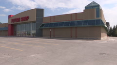 Vacant closed large retail store as economic recession worsenes Stock Footage