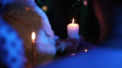 Medium shot of bride and groom wiht a candle - stock footage