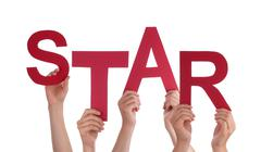 Many People Hands Holding Red Word Star Stock Photos