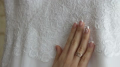 bride hand touches of the dress before the wedding - stock footage